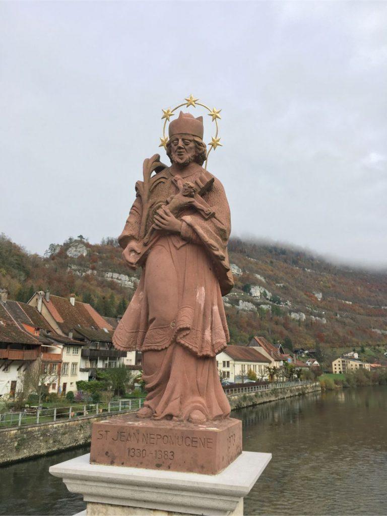 Saint Ursanne bridge statue